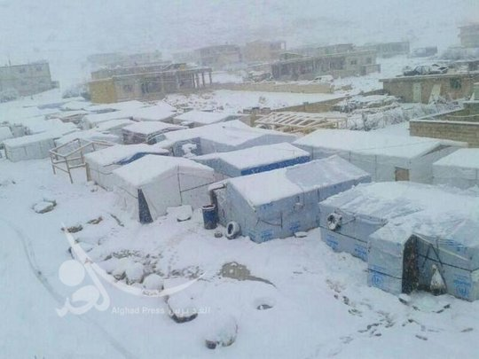 Snowing on the temporary school buildings
