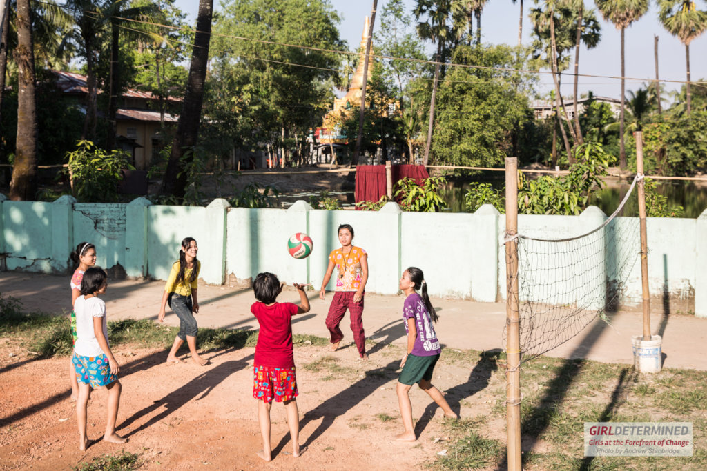 Girls play volleyball in a peri-urban area