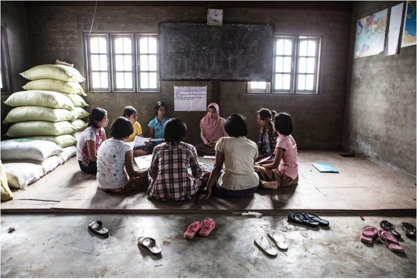 Girls work in their circle on peer communication