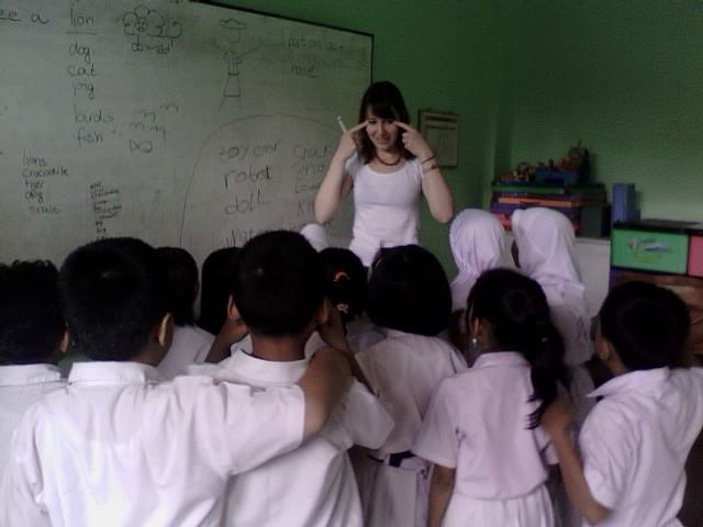 Our visiting friend, ms. Monica, teaching the kids
