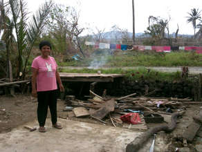 Filipino families rebuild homes after typhoon