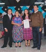 Adela with her Parents and the School Director