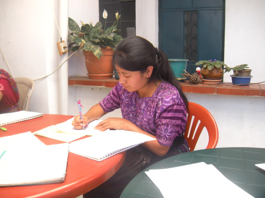 Aura writing a letter to her sponsor.