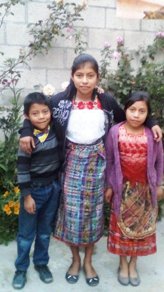 Lilian with her younger brother and Sister