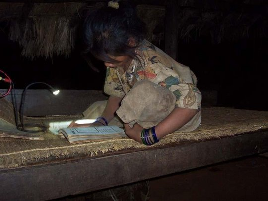 Schoolgirl with 2-LED lamp ~ studying
