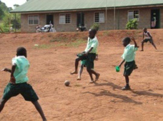 Children playing soccer at Adonai