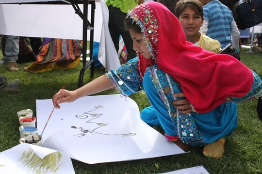 A girl paints at the Afghan Youth Voices Festival