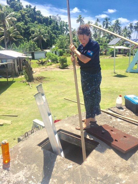 Hard at work repairing the rainwater tanks