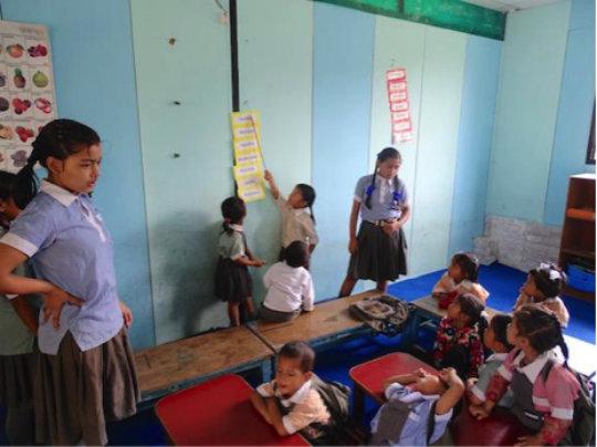 Anita Assisting in Nursery class