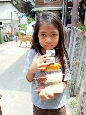 Rice for malnourished slum kindergartners