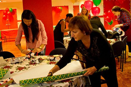 President & CEO Lori Kaplan wraps gifts