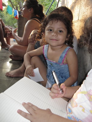Marveli drawing with her cousin