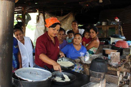 HRI staff member, Xiomara, giving a cooking lesson