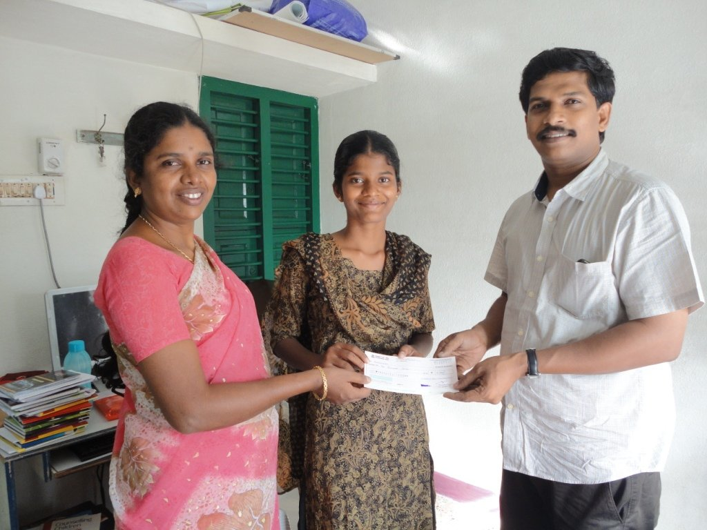 An orphan girl receiving education scholarship