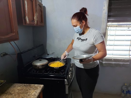 Housekeeper cooking for participant