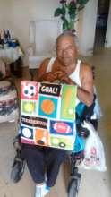 Elder with present