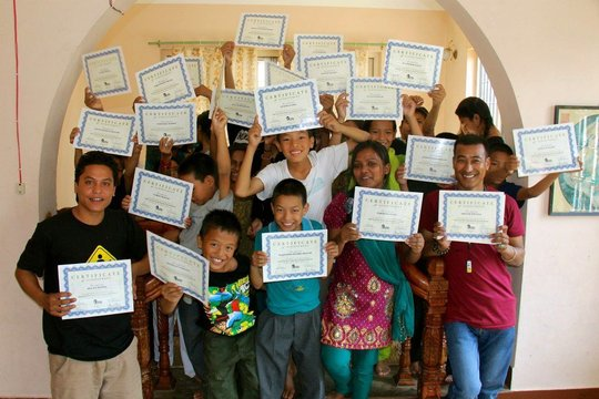 Mitrata students receive their certificates