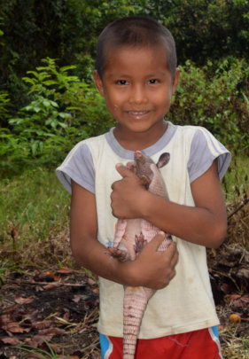 19. Boy with armadillo pet in Ancon Colonia