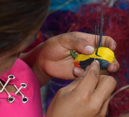 Artisan weaving wire-tailed manakin bird ornament