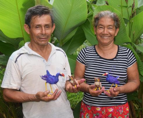 Jorge and Romelia with purple gallinules and owls