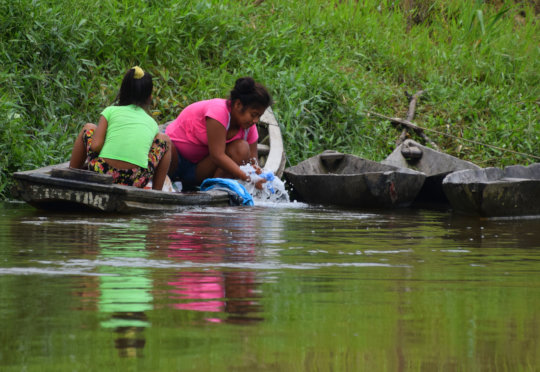 5. Women washing closes in the river