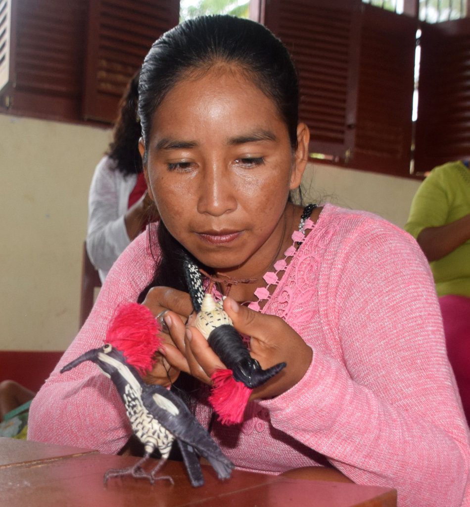 Bora artisan making lineated woodpecker