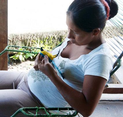 Artisan making macaw at artisan teacher workshop