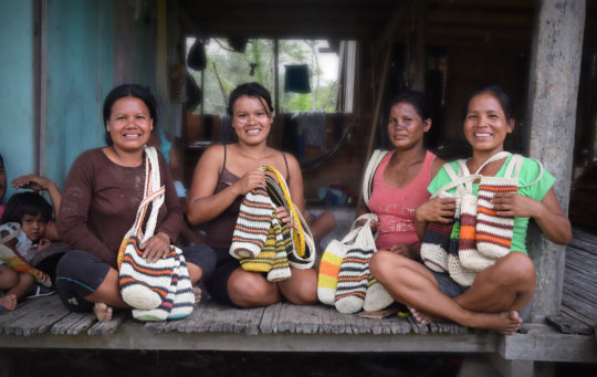 Artisans from Nuevo Peru with bottle carriers