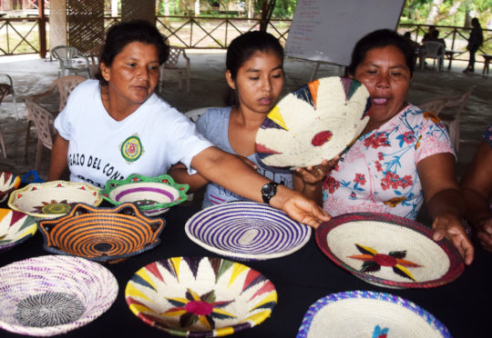 Artisans selecting best baskets for display