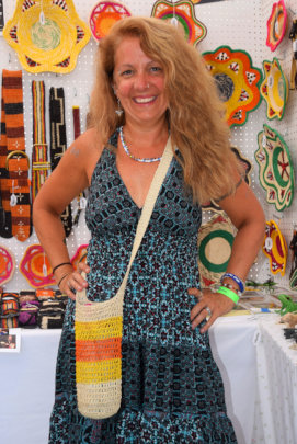 Lisa with woven bottle carrier at CACE booth