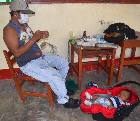 Artisan dad with baby at workshop in Puca Urquillo
