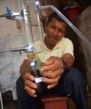 Bora team member collecting rosewood essential oil