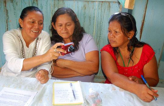 CACE donating camera to FECONA native leaders