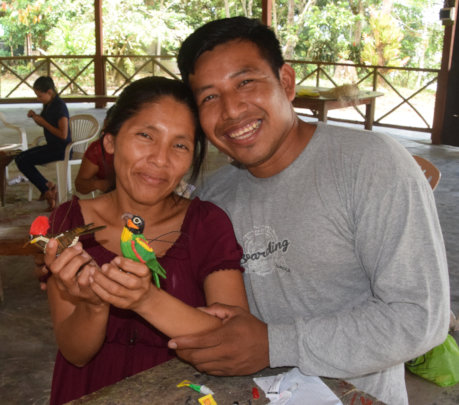 Edson and his artisan wife with two birds