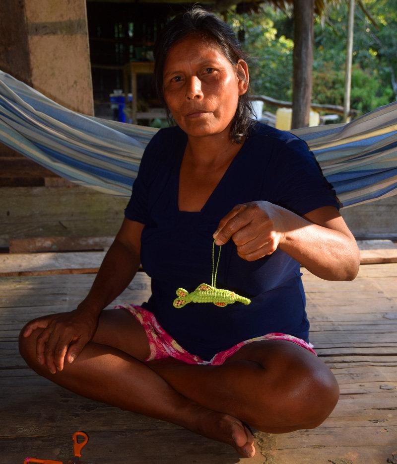 Maijuna artisan Elena and river dolphin ornament