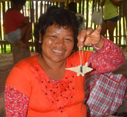 Artisan with armadillo ornament.Photo:Plowden/CACE