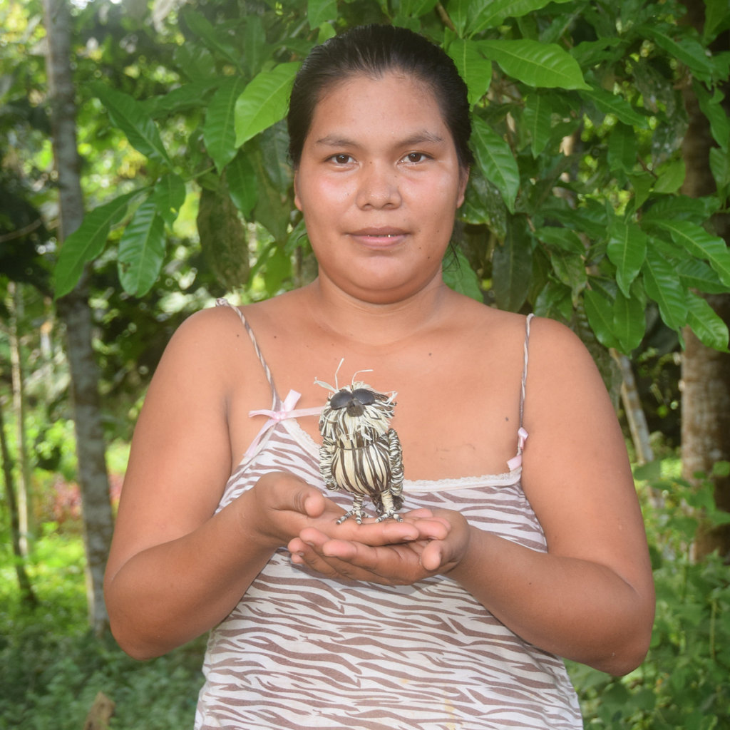 Artisan Letty with woven owl. Photo by Plowden