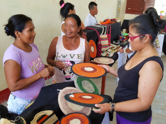 Artisans practice selling crafts to tourists