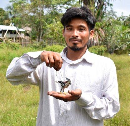 Maijuna artisan with ornate hawk eagle ornament