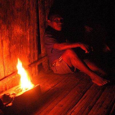 Maijuna shaman sleeping by copal resin flame