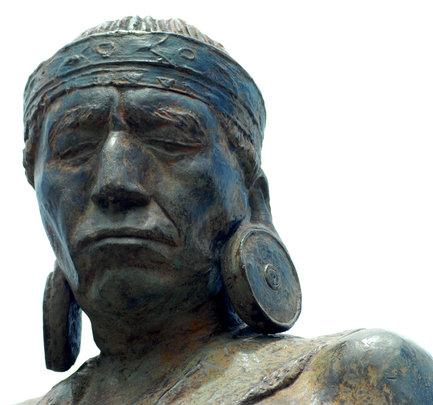 Statue of traditional Maijuna with earlobe disks