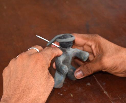 Making clay figure for 3D forest scene mandala