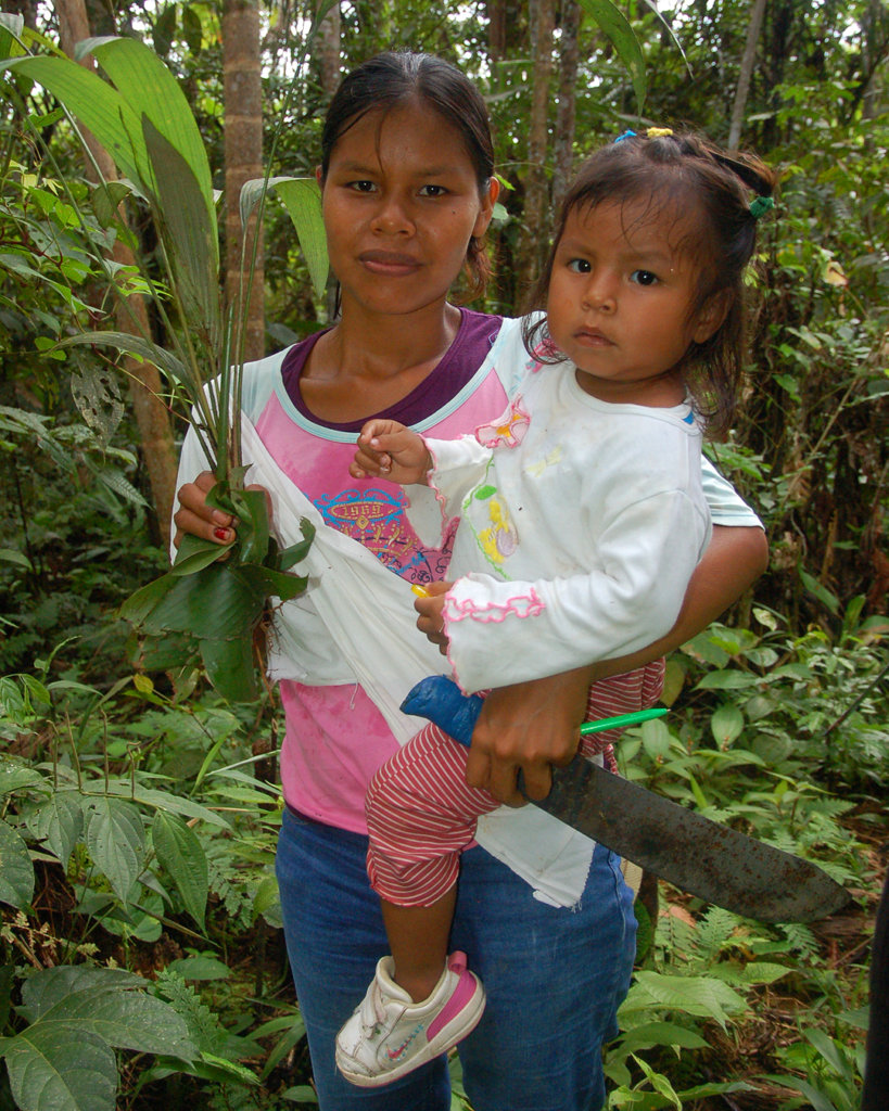 Maria with daughter and chambira palm seedling
