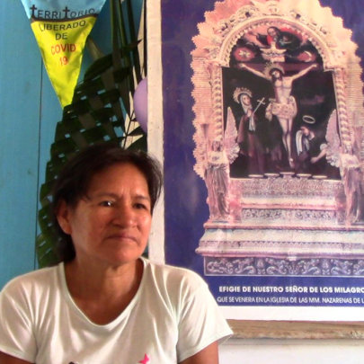 Mariela with COVID free banner