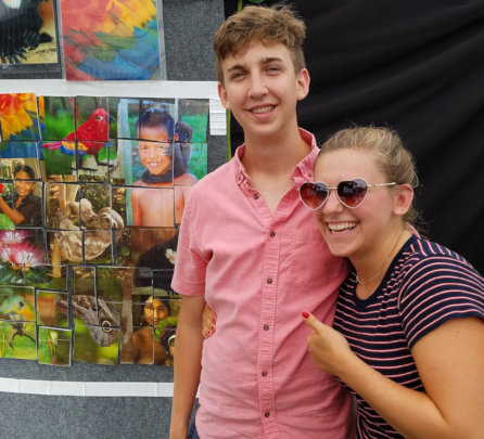 Matt and Allie and rainforest puzzle at CACE booth