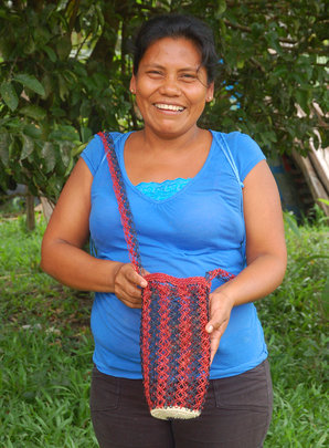 Artisan with woven chambira water bottle carrier
