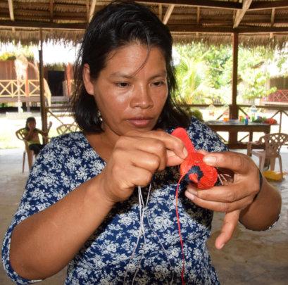 Mirian making cardinal bird ornament at Nauta