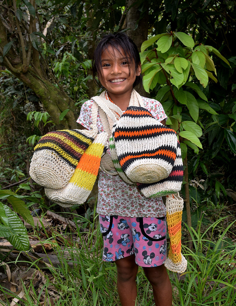 Bora artisan daughter with bottle carriers