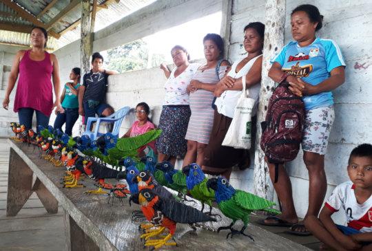 Artisans at Nuevo Peru workshop with birds