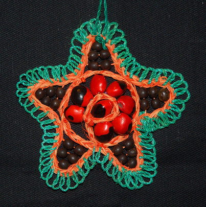 Chambira and seed ornament. Plowden/CACE